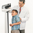 Doctor Weighing Nervous Looking Little Boy on Weight Scale — Stock Photo