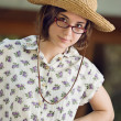 Girl Outdoors Wearing Glasses and Straw Hat — Stock Photo