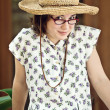 Girl Outdoors Wearing Glasses and Straw Hat — Stock Photo #9941513