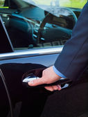 Hand on a car door — Stock Photo