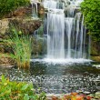 Waterfall in city park — Stock Photo