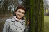 Happy woman smiling in a park — Foto de Stock