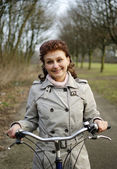 Happy woman riding a bicycle — Stock Photo
