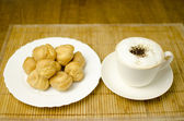 Coffee with cream puffs — Stock Photo
