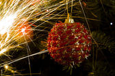 Christmas tree ball and light trails — Stok fotoğraf