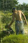 Man working on lavender field — Stock Photo