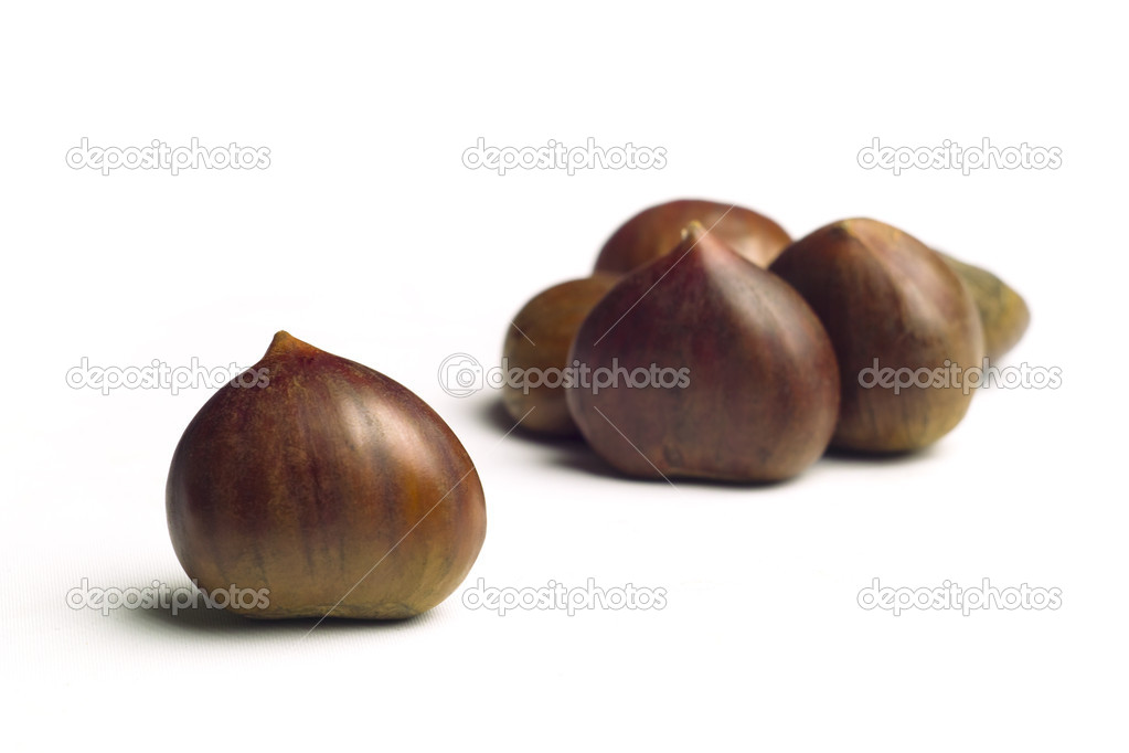 Chestnuts on white background — Stockfoto #8421158