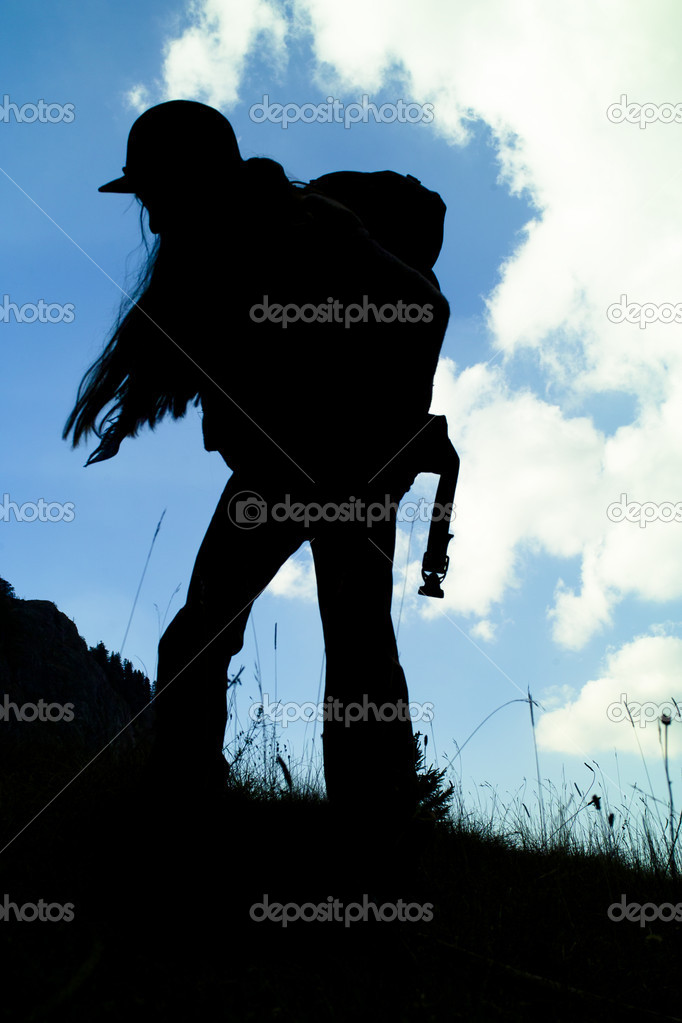 Girl with backpack hiking in the mountains — Stock Photo #8421374