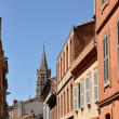 Toulouse in the south of France with typical architecture made of red bricks against bright blue sky - St Sernin basilica — Stock Photo