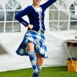 Stock Photo: Scottish girl dancer performs traditional dance