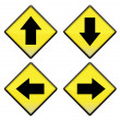 Group of four yellow road signs with arrows - Foto Stock