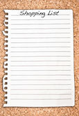 Vertical shopping list on cork background — Stok fotoğraf