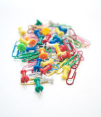 Group of paper clips and pins on white — Stok fotoğraf
