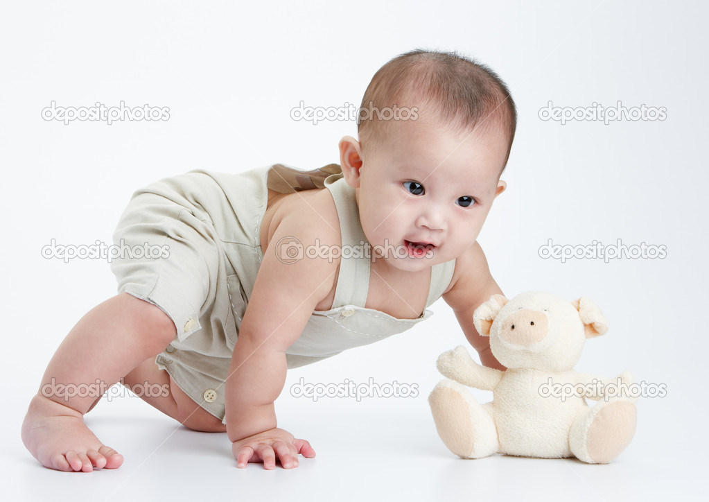 Little baby play alone, a studio shot — Stock Photo #8911491