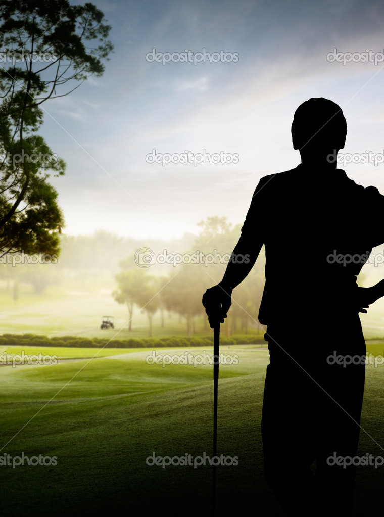 Silhouette of a golfer standing by the course — Stock Photo #8989928