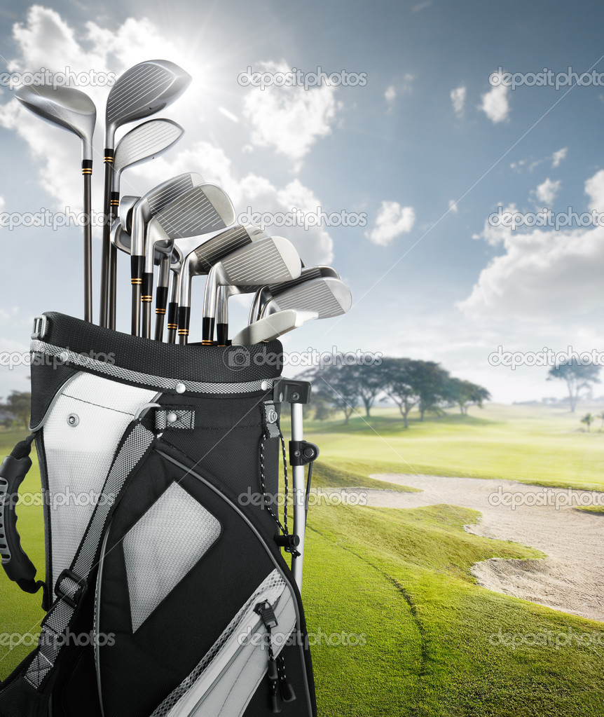 Golf equipment at the course on sunny day — Stock Photo #8989961
