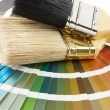 Paint brush on color chart — Stock Photo
