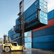 Stock Photo: Forklift lifting container