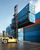 Forklift lifting container — Stock Photo