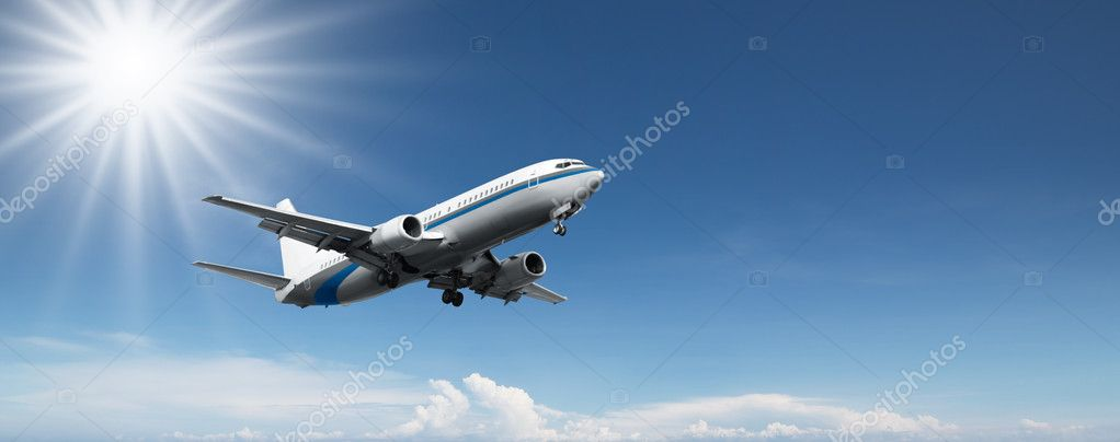 Aeroplane flying on a clear blue sky — Stock Photo #9025152