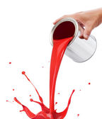 Pouring red paint — Stock Photo