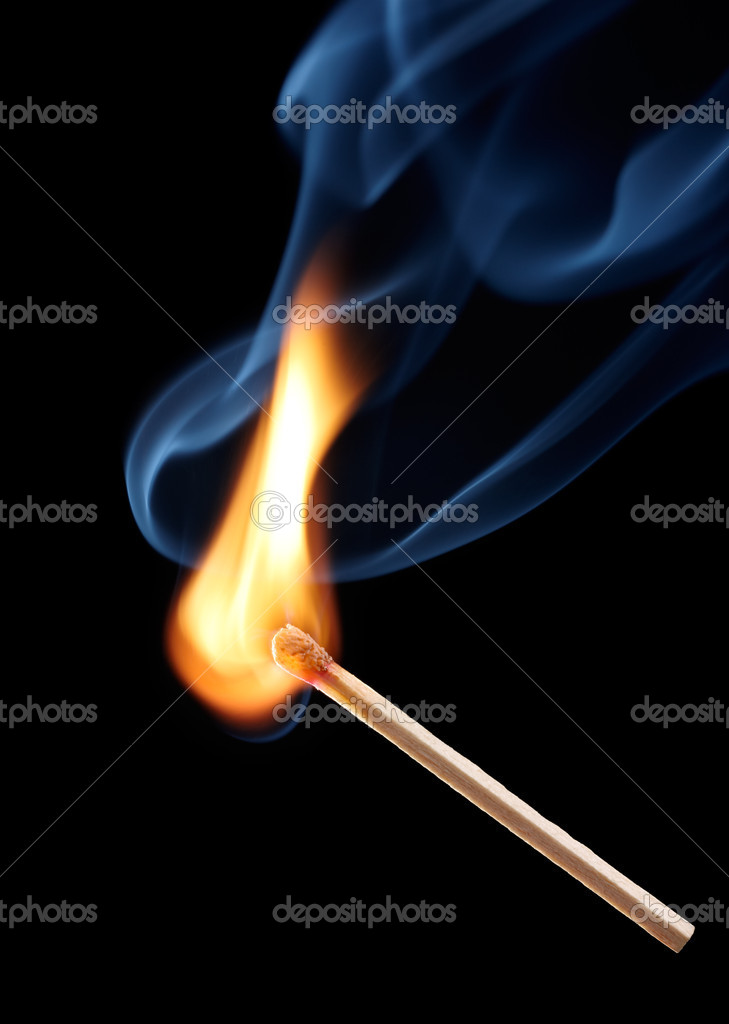 Matchstick with flame on black background  Stock Photo #9157182