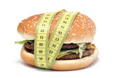 Hamburger and centimeter — Stock Photo
