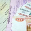 Birth certificate and money — Stock Photo