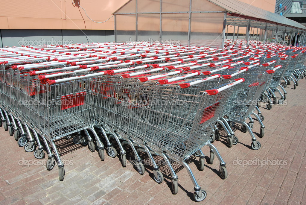 Row of supermarket shopping cart trolleys — Stock Photo #9906437