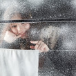 She smiles for the winter window - Stock Photo