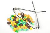 Medicine and glasses — Stock Photo