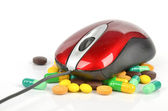 Medicine and computer mouse — Stock Photo