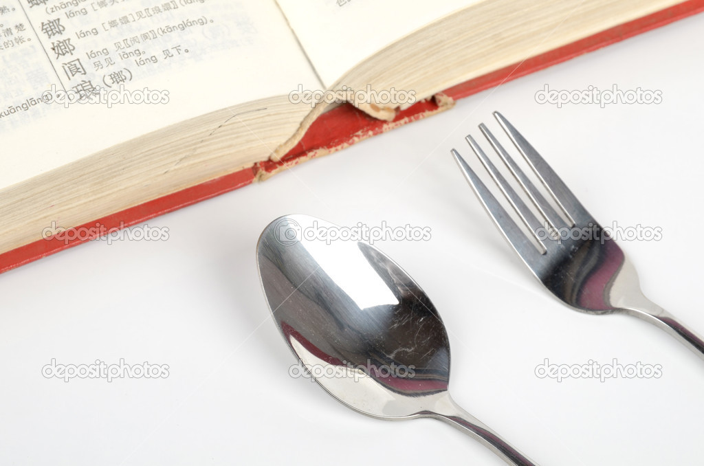 Dictionary and tableware on white background — Stock Photo #10005461