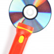 DVD and flashlight — Stock Photo