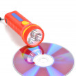 DVD and flashlight - Stock Photo