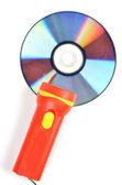 DVD and flashlight — Stock Photo