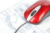 Blueprint and computer mouse — Stockfoto