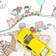 Children's drawing and toy car — Stock Photo #10117673