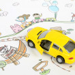 Children's drawing and toy car — Stock Photo #10117780