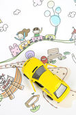 Children's drawing and toy car — Stock Photo