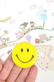 Children's drawing and smiling face — Stock Photo