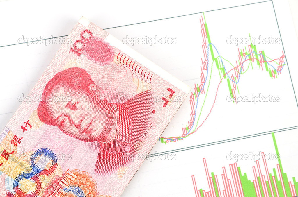 Chinese currency on a trend graph page — Stock Photo #10131914
