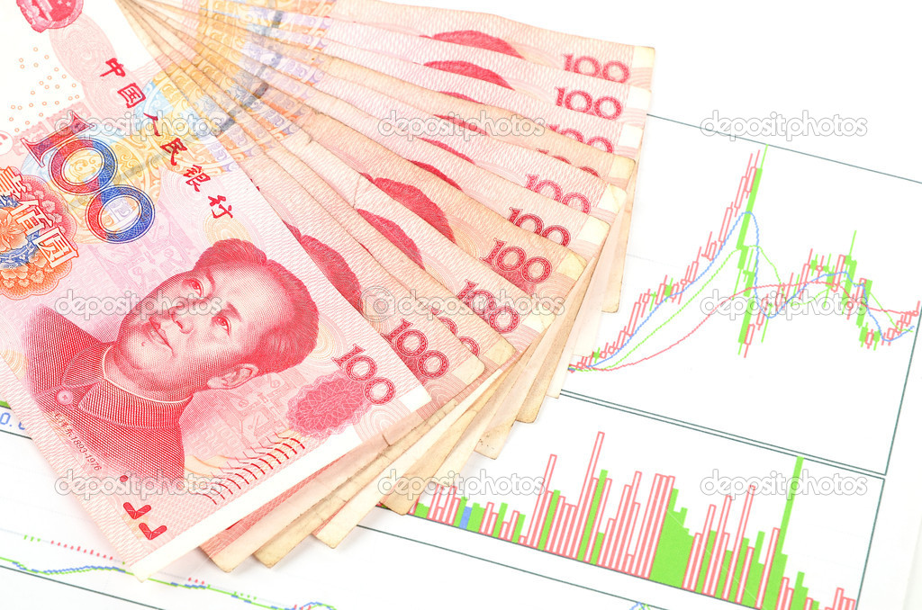 Chinese currency on a trend graph page — Stock Photo #10131999