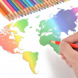Color pencils and world map — Stock Photo