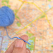 Wool ball and map — Stock Photo