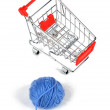 Wool ball and shopping cart — Stock Photo #8470978