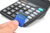 Calculator and SD card — Stock Photo