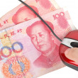 Computer mouse and chinese currency — Stock Photo #8597664