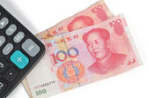 Calculator and chinese currency — Stock Photo