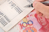 Chinese currency and passbook — Stock Photo